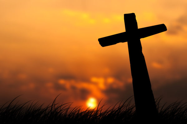 Crosses on a hill and sunset